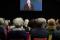 Syntolkning: Publik framför videohälsning av Stefan Löfven. Foto: José Figueroa