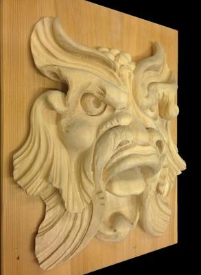 Snidad maskaron i trä - Stockholms Förgyllning & Bildhuggeri AB