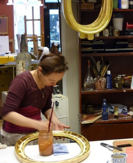 Lotta, the gilder: water gilding of an oval girandole mirror in Gustavian style