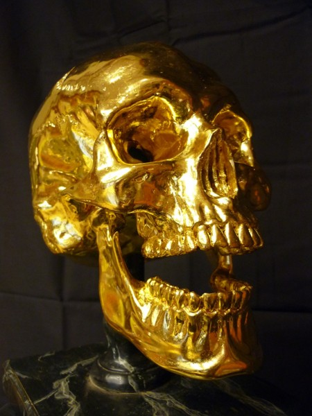 Casted and gilded skull. Natural size skull that is covered with gold leaf
