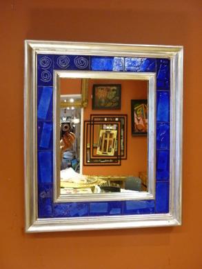 Silverspegel med blå emalj.