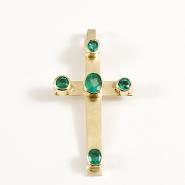 Kors i 18 k guld med infattade smaragder.