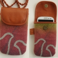 """Smartphone bag to hang around  your neck. It´s made in reindeer leather,  with hand-printed decoration """"Giron"""" on wool."""