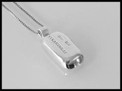 Halsband i 925silver med silvertacka. Höjd ca 2,5 cm - 950 kr