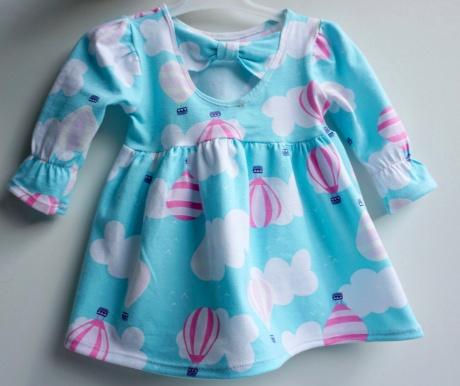 Babyklänning i UV tyg