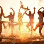 21131228-large-group-of-young-people-enjoying-a-beach-party