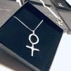 Kvinnotecken i silver NR 7