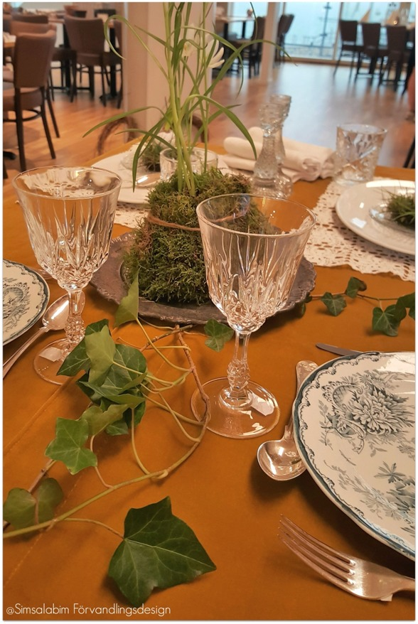 Dukat bord med gröna inslag och secondhand från Erikshjälpen