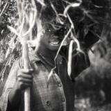 Child with firewood I, Uganda