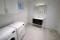 Helkaklat badrum med klädvård