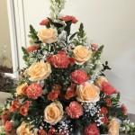 Hög dekoration i orange/aprikos