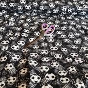Fotbollar på svart botten