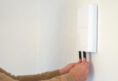 Om din brandfilt är fäst på en vägg
