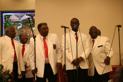 A men's choir at the closing concert