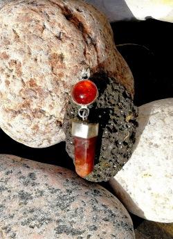 Amber with red rabbit quartzcrystal in 925 silver Stjernhem De4sign
