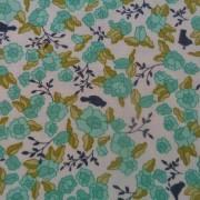 Bomullstyg grön blomma (Tuppence)