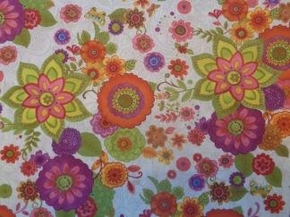 Bomullstyg orange-lila-gröna fantasiblommor (Spice Garden)