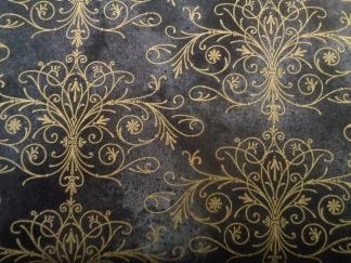 Bomullstyg svart/guld (Floral Impressions)