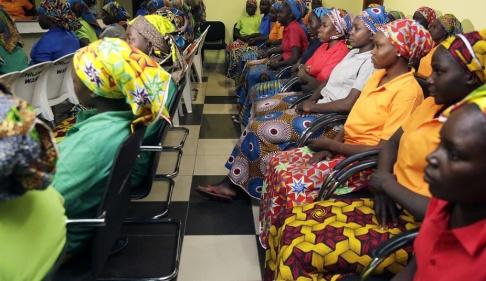Sunday Alamba/AP/TT Så kallade Chibok-flickor som friades 2017, drygt tre år efter att de kidnappats av Boko Haram. Arkivbild.