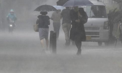 Daisuke Urakami/AP/ TT Japan har de senaste dagarna drabbats av kraftiga skyfall.
