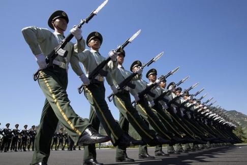 Ng Han Guan/AP/TT Kinesisk militär under en uppvisning. Arkivbild.