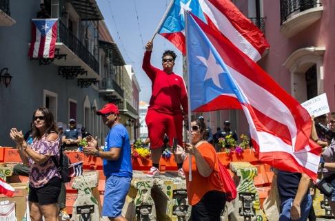 Dennis M. Rivera Pichardo/AP/TT Demonstranter i Puerto Rico.