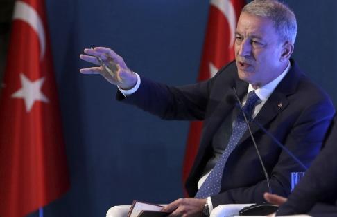 AP/TT Turkiets försvarsminister Hulusi Akar meddelar beslutet om ledningscentralen under ett möte i Ankara på onsdagen