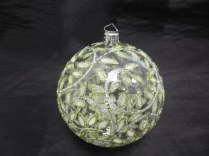 Glaskula med gröna blad