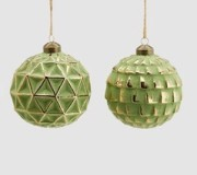 Glaskula grön med guldmönster i 3D