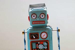 En turkos plåtrobot. En virtuell hjälper dig att göra saker du inte kan eller vill göra, inom den digitala världen.