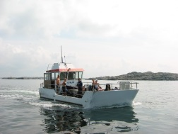 "My first boat ""Cyklop"". This was a slow glass bottom boat with a great deck for al the dive gear that we brought."