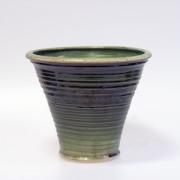 Slinga - krukor i grön glasyr, konkav modell