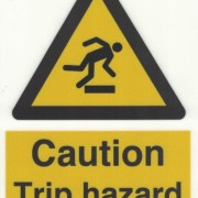 Skylt Caution Trip Hazard