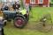 GFHK-medlem(1910) Krister Gustavsson med BM-traktor och tillkopplad gammal hästräfsa.