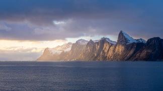 Solnedgång över fjorden -