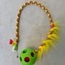 Gröna bollar, olika utföranden - Grön boll lång med inflätad fuskpäls