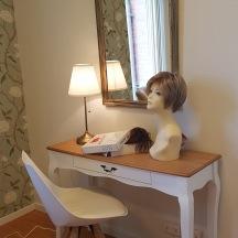 Utprovning av peruk i enskilt rum