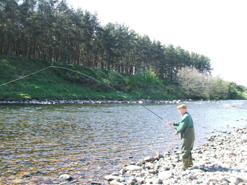 Ray Cuthcee playing a salmon