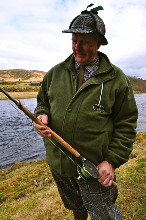 Ghillie Davie Goodfellow examines Colin Innes traditional equipment