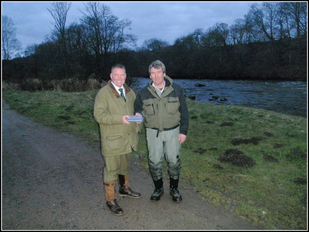 Opening day –Ken Reid presents angler Graeme Scott with a prize for the honour of landing the first salmon of the 2012 season which was 12lbs and was landed at Commonty at 9.45 am on opening day.