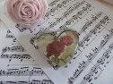 charmig brevpress med ros