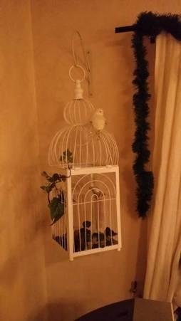 Fågelbur med julfåglar hos denna kund