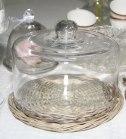 Underbar glasklocka på rottingfat
