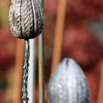 Växtstöd rakukeramik på järnpinne