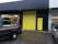 Mekonomen-gul lackerad Smalpanel 2500x3000 stor garageport IND40 med axelmonterad motor.