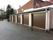 Fem nymonterade garageportar / takskjutportar åt en bostadsrättsförening i Nynäshamn.