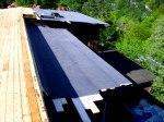 Reperation av tak med aluzinkplåt.
