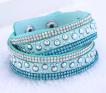 Läderarmband med strass & silverdetaljer - Ljusblått  armband med strass och silver detaljer