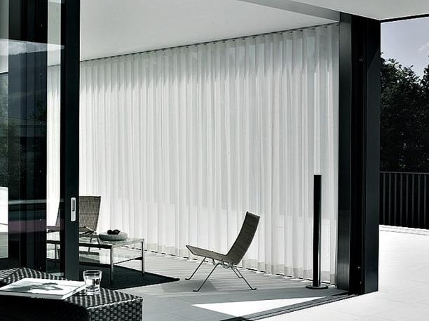 Lounge och hotellgardiner med Wave skena - Alegni Interiors - Gardinmakare i Stockholm