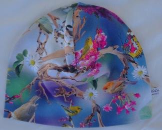 Blommor-Ceris ,Vita blommor o Fåglar - 34-38 cm. Ca: 0-3 månader